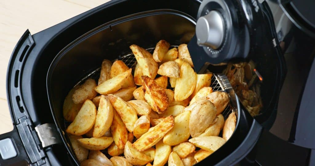 potaot chips cooked in an air fryer. Cooking method - air frying