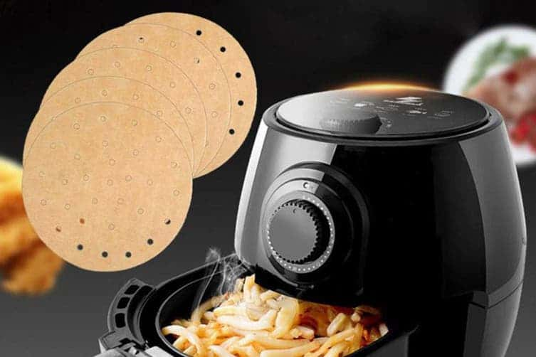 Air Fryer liners and an air fryer full of cooked potato chips