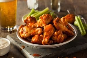 Air fired, homemade buffalo wings with a beer and dipping sauce, cooked in an air fryer